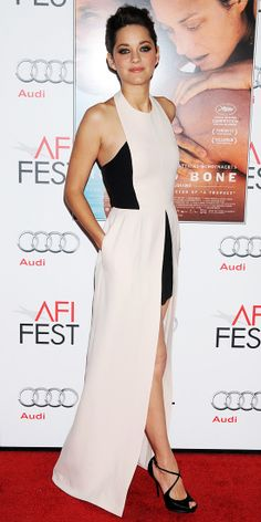 Marion Cotillard worked all angles of her peek-a-boo Christian Dior gown at the AFI Fest screening of Rust and Bone. She finished the look with the label's strappy sandals and Chopard jewels.