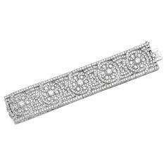 Fine diamond bracelet, Van Cleef & Arpels, 1920s Of scroll and open work design, set with circular-cut diamonds, length approximately 190mm, signed Van Cleef & Arpels, numbered, French assay and maker's marks, two small diamonds deficient.