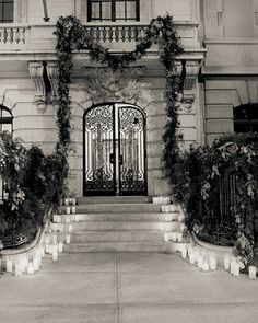 At night's end, guide tired revelers home with a candlelit path. Glowing candles in simple glass containers placed along the front steps lend romance. A spectacular garland by event planner Michelle Rago frames the entrance. Wedding Themes, Wedding Designs, Wedding Decorations, Wedding Ideas, Lantern Decorations, Aisle Decorations, Wedding Receptions, Wedding Stuff, Glamorous Wedding