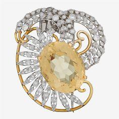 A citrine, diamond, eighteen karat gold and platinum brooch, Seaman Schepps
