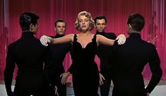 """The dress, the gloves, the shimmering hair! Rosemary Clooney looking sultry in """"White Christmas."""""""