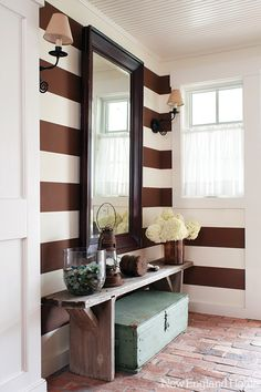 unexpected and excellent treatment of a small main entry. excellent feng shui as log as the mirror is not facing the front door  http://fengshui.about.com/od/fengshuicures/f/feng-shui-mirror-main-door.htm