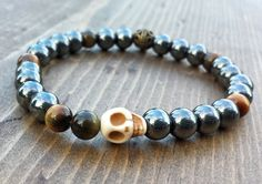Hematite and Tigers Eye with a Skull by NidraBeads on Etsy Spiritual Jewelry, Tigers, Jewelry Making, Skull, Beaded Bracelets, Trending Outfits, Beads, Unique Jewelry, Handmade Gifts
