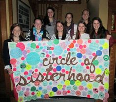UVM's Panhellenic sold circles to raise money for Circle of Sisterhood to support their efforts of furthering girl's education in developing countries. Here's the Panhellenic Council with the banner covered in circles! Chapters and clubs wrote their names on the circles they donated, some choose to write inspirational messages. #service # NPC #UVM_FSL