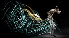 """Photographer Atton Conrad created these transient dresses using his own light painting techniques. This involved his own specially made """"light brushes"""" that allow him to create the intricate patterns and give him a much greater command of where the light goes, while operating the camera remotely. The images were created for a shoot for 125 Magazine."""