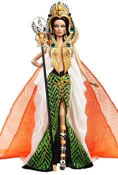 Barbie® Doll as Cleopatra  This striking portrayal of Barbie® doll as Cleopatra captures the nobility of a divine queen. She wears a dazzling cape and skirt with exotic green and black design, featuring a golden rope embellishment. Her extravagant headdress lends a regal air with its ornate design with scarab and cobra details. The faux jewel and golden earrings, dagger, and scepter reveal the pharaoh's exotic origin. History and striking elegance meet to create an extraordinary doll.