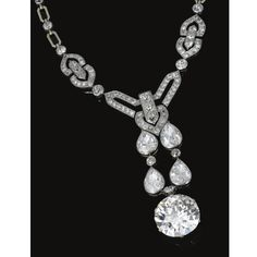 IMPORTANT DIAMOND NECKLACE, CHAUMET, CIRCA 1915 The front millegrain-set with circular- and single-cut diamonds, suspending a fringe of pear-shaped stones terminating on a circular-cut diamond weighing 27.62 carats, length approximately 435mm, mounted in gold and platinum, unsigned, French assay and maker's marks.