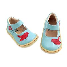 'Pio Pio' - 	A charming pair of lovingly handmade soft, baby-blue leather, Mary Jane shoes to delight your little girl.    Embellished with an adorable bird silouette in red leather, set strikingly against the contrasting baby-blue upper and finished with a leather button-shaped cutout and suede stitch on the closure.    Leather lined for breathability, this adorable shoe also features a padded collar for comfort, rubber sole for grip and flexibility and a velcro strap for quick and easy…