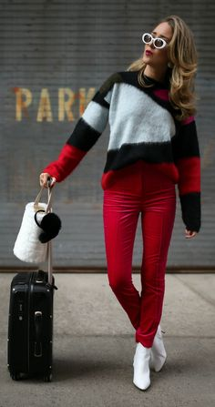 12 Stylish Ski Trip Essentials   //  Black red white color block sweater, hot pink velvet skinny pants, white heeled pointy toe booties, white oval sunglasses, white fur bucket bag, black earmuffs, silver statement earrings, black suitcase {DVF, Diane von Furstenberg, Elizabeth and James, winter style, what to wear, travel outfits, fashion blogger, cold weather}