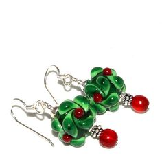 Festive red and green holly lampwork  glass and sterling silver earrings from Andreas Jewelry. These holly beads were made by a glass artisan here in the USA.