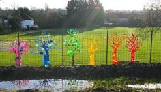 Rainbow Trees From Up-cycled Plastics Recycled Art Recycled Plastic Preschool Garden, Preschool Art, Preschool Playground, Sensory Garden, Outdoor Education, Outdoor Learning, School Art Projects, Art School, Fence Weaving