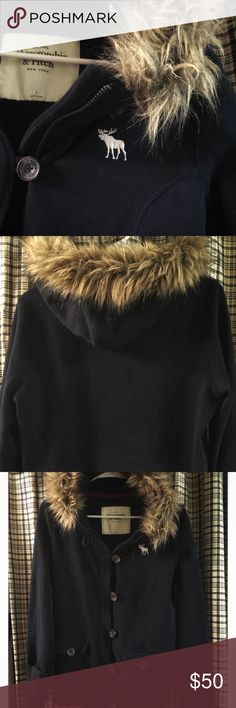 A&F | Faux Fur Trim Hood, Fleece Lined Jacket Sz L Beautifully designed Navy Blue Fleece Lined Jacket from Abercrombie & Fitch! This features button and zipper closure with red plaid details in the pockets and interior! The Fleece is soft inside and the sleeves are long to cuff at the wrist. This is a great statement jacket! Classic navy blue!   Size Large A&F Preowned Never been through the dryer, always air dried. Abercrombie & Fitch Tops Sweatshirts & Hoodies