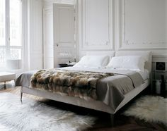 I like the simple bed linen letting the ornate walls be the touch of luxury in this room
