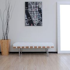 Give your home a modern upgrade with this stunning white leather bench from Andalucia. The strong white leather wooden bench features chromed steel legs and a solid birch seat. The polyurethane-coated leather cushion provides a soft surface for sitting.