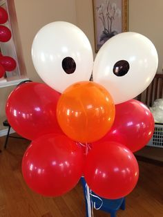 Elmo Balloons! We drew on the black eyes with magic marker.