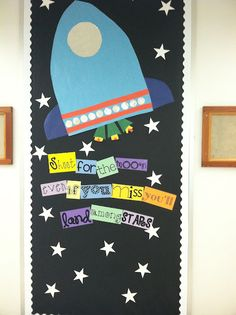 """And Out-Of-The-World inspirational bulletin board from Extra Special Teaching! Could change to """"We are shooting for the moon this year"""" and put the kids names on stars -good door design for first day of school."""