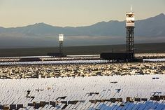 Two of the three solar towers and heliostats at Ivanpah solar thermal power plant