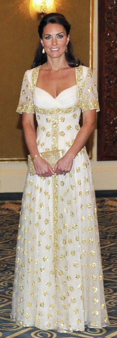 Catherine, Britain's Duchess of Cambridge, poses before an official dinner hosted by Malaysia's King Sultan Abdul Halim Mu'adzam Shah