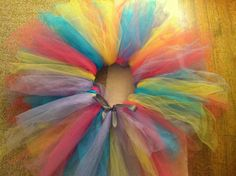 DIY tutu! It's easy and all u have to do is get some tulle and ribbon! Then u cut the tulle and tie knots around the ribbon!