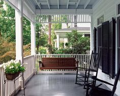 Rocking chairs and a porch swing provide a perfect place to enjoy a sultry summer evening.