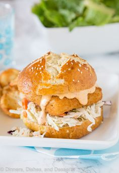 Spicy Fish Sandwich - Crispy fish sandwich with creamy coleslaw and a spicy tarter sauce. Easy dinner recipe for night of the week. Coleslaw Sandwich, Sandwich Sauces, Fish Sandwich, Fish Recipes, Seafood Recipes, Cooking Recipes, Sandwich Recipes, Dinner Recipes Easy Quick, Quick Easy Meals