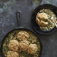 In this vegetarian white bean potpie recipe, kale and hearty white beans are topped with easy, homemade chive biscuits.