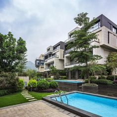 NEXT architects surrounds housing complex with water and lush greenery in china