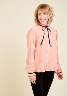 If pleats are what please you, then this coral blouse will charm you to your core! With a stand-up collar - accented with a black velvet tie to coordinate with its buttoned sleeve cuffs - and a voguely vintage-inspired vibe, this feminine top maintains your glorious glamorousness.