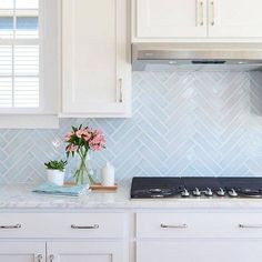 kitchen backsplash trends light blue herringbone backsplash