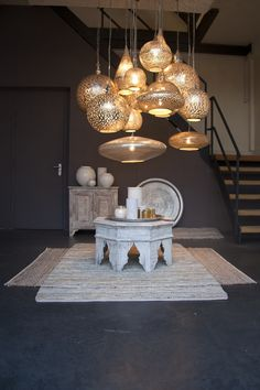 This impressive image shows a selection of the pendant lights, furniture and rugs from Zenza. http://www.pomegranate-living.com/brands-zenza.irc