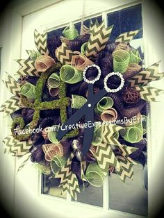 Beautiful moss deco mesh wreath for a salon studio. Brown, moss green and burlap deco mesh with moss green chevron burlap ribbon. 'A' covered in sheet moss and scissors with added rhinestone jewels. $85 *custom colors and style available*