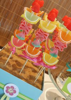 Tropical candy skewers #luau...or try real orange wedges, grapes and strawberries for a healthier bite!