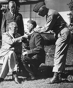 Franklin Roosevelt awarding Brigadier General William Wilbur the Medal of Honor award, 22 Jan 1943; note Geroge Marshall in background and George Patton assisting | World War II Database