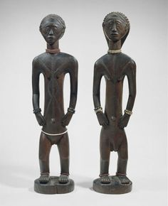 Figure pair  Tabwa peoples, Democratic Republic of the Congo  18th to 19th century  Wood, beads  Tabwa figure carvings of ancestors bear scarification patterns called balamwezi, triangle designs that refer to the rising of the new moon and lunar phases....
