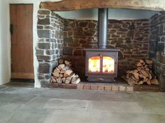 This fireplace was sandblasted before the chimney was lined. this is the finished job, and what a transformation! We lined the chimney using a 200mm 904 grade flexible liner and insulated it with Rocklap insulation tubes as it was a thatch property. The Stove is a Clearview 650 stove in Golden Fire Brown looks fantastic!