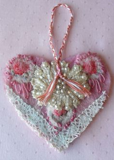Pink felted hanging heart embellished with embroidery, beads and lace.. via Etsy.