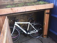 Bikes with a green roof shed built around them!