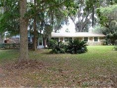 Earleton Real Estate - 10727 Northeast 1469, Earleton, FL 32631  Take the winding road to your own Paradise. 3BD/2BA, 2104 sq.ft.(2404 under roof) brick home on 3.43 gorgeously landscaped acres. Looks like your own special playground.