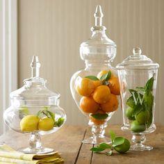 3 Boles transparentes en distintos tamaños con naranjas, limones y limas. Cocina o Mueble bar