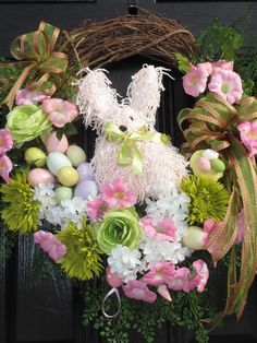 Spring Wreath, Easter, Wreath, Easter bunny Wreath, Easter egg Wreath, Raz Imports yarn bunny, pastel Easter colors. $151.00, via Etsy.
