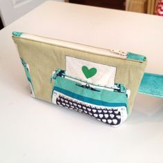 my all time favorite zipper pouch tutorial! I make it a little bigger though. Can't tell you how many I have made.