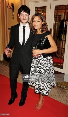 Iwan Rheon (L) and Antonia Thomas attend the South Bank Sky Arts Awards at The Dorchester on January 25, 2011 in London, England.