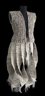 All woven from different brands of Newspaper to achieve different hues and textures, this is the wild fashion of Italian Ivano Vitali, knitted and crocheted, magical newsprint.