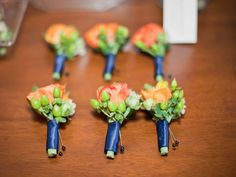 orange green navy blue boutonnieres utah wedding florist calie rose