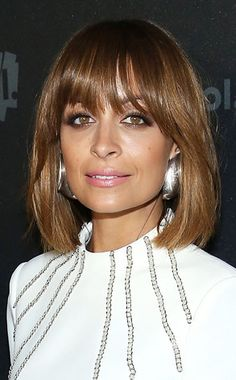 Great cut for a square face - bangs shaped around the face, side swept slightly and cut below the brow line and the rest of the hair length falls below the chin line.