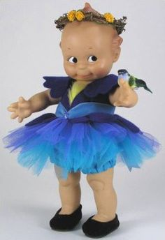 A Bluebird of Happiness - a sweet baby #doll in a blue dress.