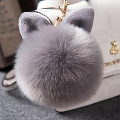 Faux Fur Key Chain | How cute is this Pom Pom? Wear it on your purse or with your keys!
