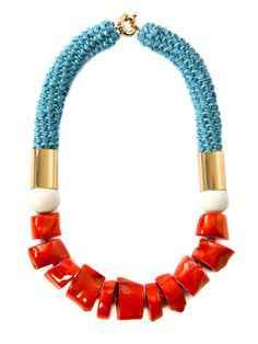 Orange Coral Slice Beads, Orange Small Czech Glass Beads & White Coral Spheres on Sky Blue Woven Kangaroo Leather. Hard Gold Plated Tubes & Clasp. In a Limited Edition of 6 only.  Hand made in Australia by Lyn&Tony.