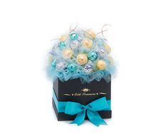 This stunning bouquet is sure to please your loved one. Complete with 15 Ferrero Rocher Chocolates, 10 Bacio Perugina chocolates and 15 Lindt Coconut Lindor Truffles. Perfect gift at any occasion!