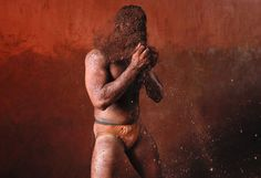Caption: A wrestler rubs his hands with mud to prevent slipping due to sweat, during a traditional mud wrestling (Kushti) bout at the Akhaara centre in Kolhapur, about 400 kms (250 miles) south of Mumbai, February 14, 2012. Fewer people are taking up Kushti, according to the sport's coaches, as young athletes turn instead to mat wrestling to gain access to top international sports competitions.